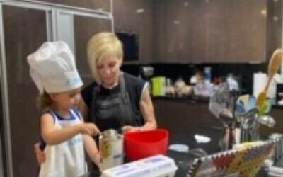 Marianne Garber with 3-year-old Zadie baking for the holidays.