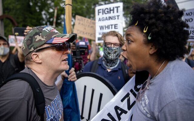 A counter-protester and right-wing militia member confront each other.// Nathan Posner of AJT
