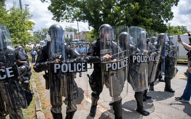 Stone Mountain riot police clear protestors from the area after clashes.  // Nathan Posner of AJT