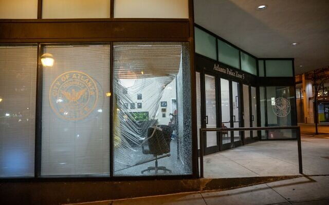 A broken window is seen at the Atlanta Zone 5 police precinct that was caused by a rock thrown by protesters. // AJT's Nathan Posner