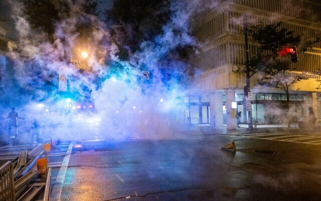 Fireworks thrown by protestors go off in front of the Zone 5 police precinct in downtown Atlanta on the evening of Aug. 25. // AJT's Nathan Posner