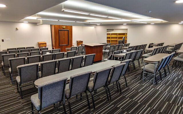 The renovated Beth Jacob daily shul includes flexible seating, tables and new library.