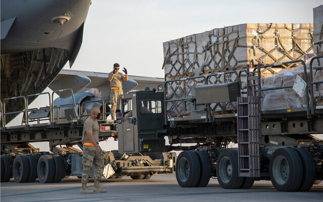 US Air Force personnel load humanitarian aid supplies onto a plane bound for Beirut, at Al Udeid Air Base, Qatar, August 6, 2020. (US Air Force/Staff Sgt. Heather Fejerang)