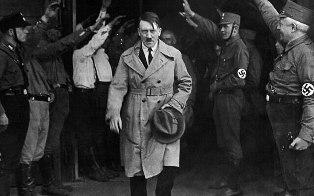 Adolf Hitler and Nazi party members before World War II (public domain)