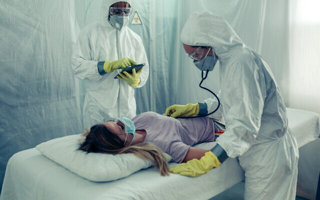 Doctors treat an infected patient.
