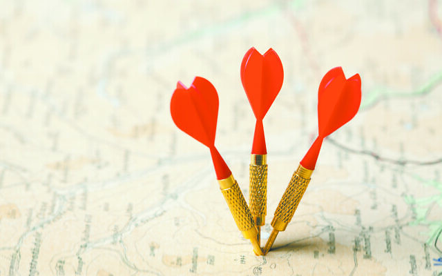 Three red darts in a shallow focus road map