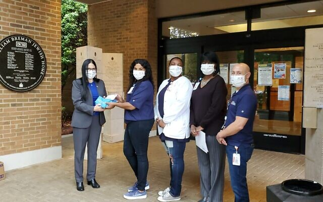Consul General Sultan-Dadon delivered masks and holiday greetings to those caring for seniors at The William Breman Jewish Home.