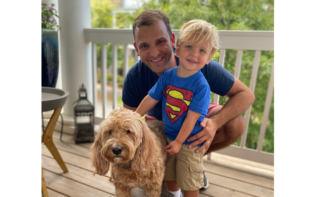 Matthew Fishman and son Austin, along with Nola, pose for a photo.