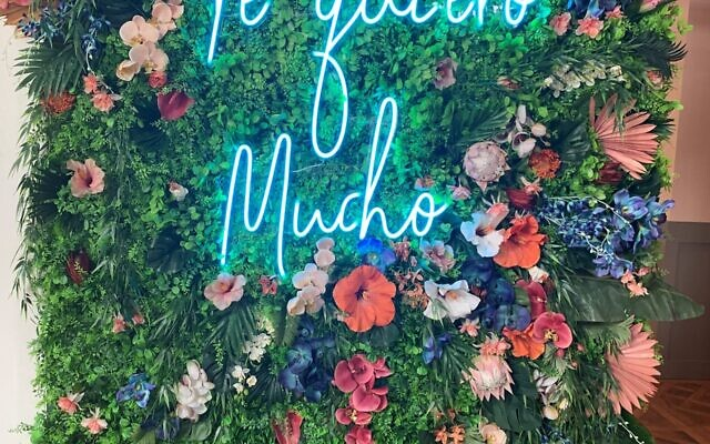 """Te Quiero Mucho"" wall greets customers."