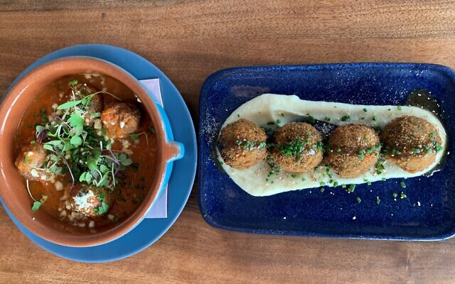 "Top Beyondigas – Plant-based luscious tomato sauce ""meatballs."""