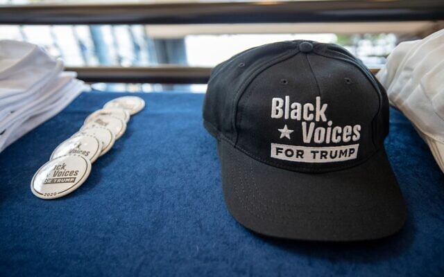"""Black Voices for Trump"" merchandise is displayed at a rally for President Trump focused on his economic plan for African Americans. // Nathan Posner for the AJT."