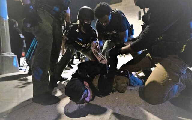 A protester is arrested by Atlanta police officers. // Nathan Posner for the AJT.