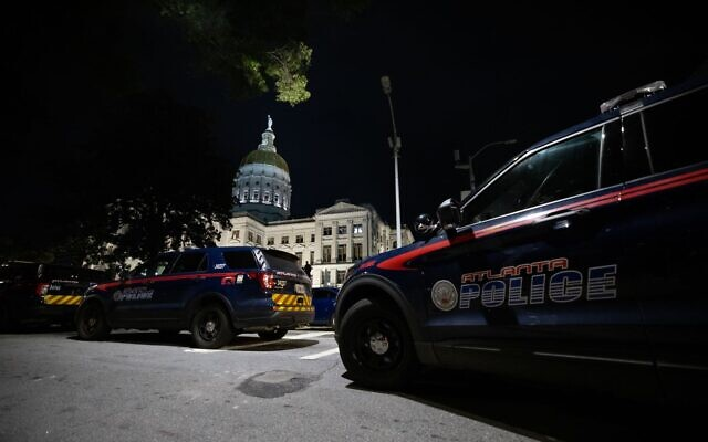 Atlanta police cruisers are seen stationed in front of the Georgia State Capitol Building after protesters clashed with police.// Nathan Posner for the AJT.