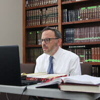 Rabbi Adam Starr teaches virtual classes at AJA three days a week.