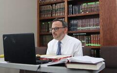 Rabbi Adam Starr teaches virtual classes at AJA three days a week.