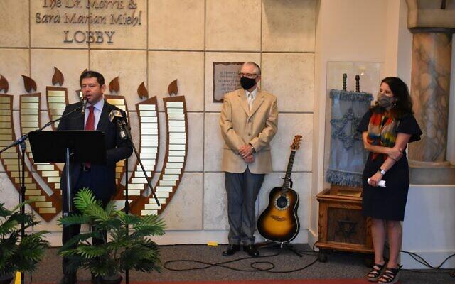 Photo by Stephen Boyd// Kol Emeth Rabbi Larry Sernovitz begins the gathering as cantorial soloist Blake Singer and ADL's Allison Padilla-Goodman look on.