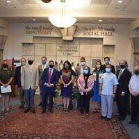 Photo by Stephen Boyd//More than a dozen interfaith and community leaders attended the event to show support or speak at the gathering.