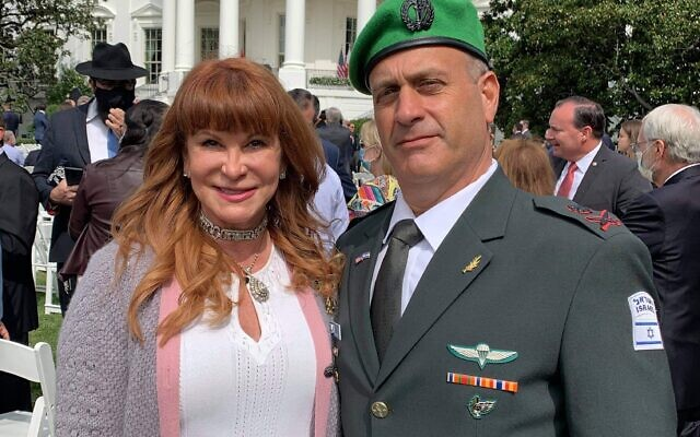 Evans poses with Brig. Gen. Yehudah Fox, defense attaché, in Washington after the White House ceremony.