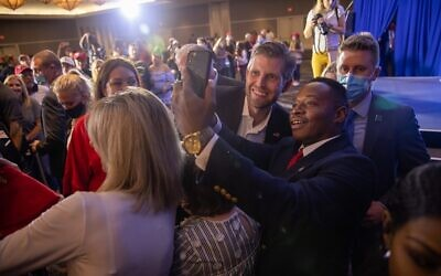 Eric Trump takes a selfie at a rally in support of his father near Hartsfield-Jackson Atlanta International Airport.// AJT Nathan Posner