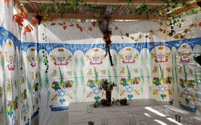 """Henry Benamram said his sukkah fits six people.  Food will be served """"family-style and they will not wear a mask because the number of people they invite will be less than in previous years."""""""