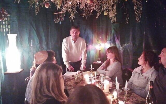 Friends and family enjoyed Shabbat dinner in Eric Miller's sukkah last year.
