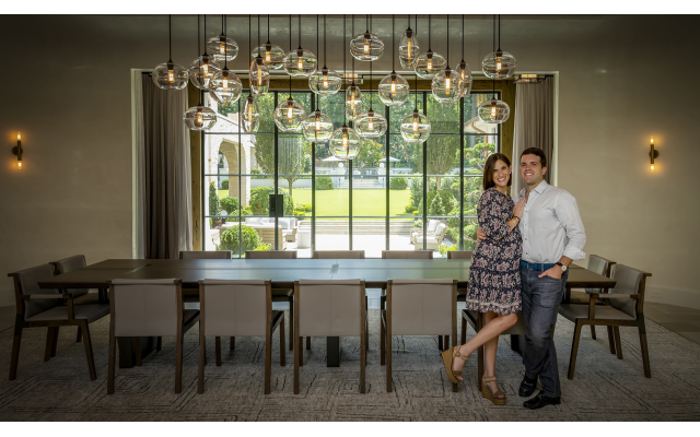 Photos by Duane Stork // Sabrina and Sean Belnick enjoy entertaining in their dining room.  The floating globe cluster lighting was custom-designed and installed. The outside view is to a glorious courtyard of bonsai and Japanese maples.