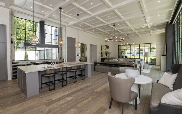 The Belnick kitchen (left) opens to the expansive great room. Sabrina is fond of handcrafted ceiling detail.