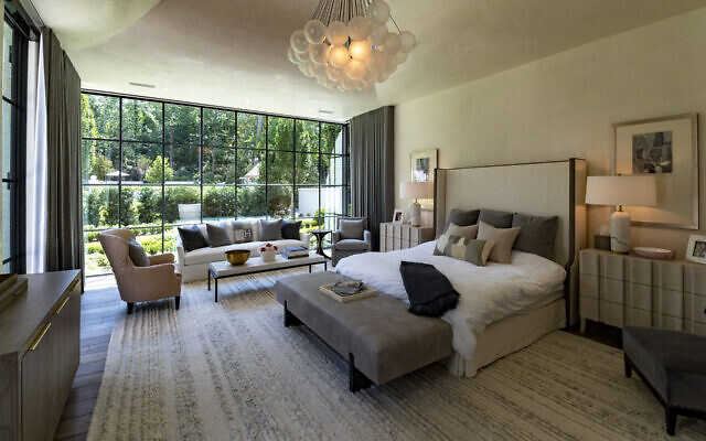 Sean describes the master bedroom as a three-sided glass box. Sabrina refers to the chandelier as cloud-like.