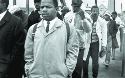 John Lewis nearly died on the Edmund Pettus Bridge in Selma, Ala., in 1965 marching for Black rights.