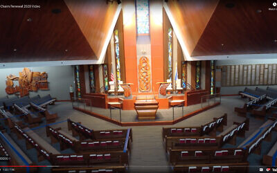 Blue tape on the pews kept congregants in attendance seated at a distance from each other.
