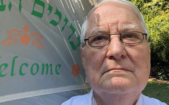 Yudelson takes a selfie in front of his sukkah.