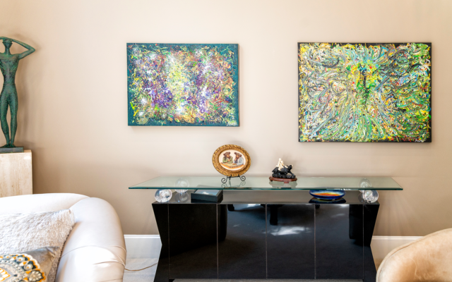 "Duane Stork // The north side of the living room is adorned by two of Printz's acrylics on canvas: 36-by-48 inch ""Blue Dog,"" right, and 30-by-40 inch ""Lake,"" left, both layered in the style of Jackson Pollock."
