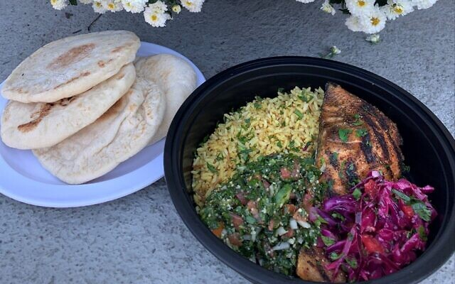 The herb-crusted salmon came with fragrant rice, red cabbage and tabouli.