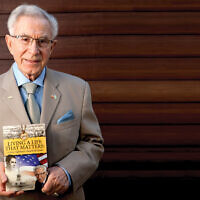 """Ben Lesser with his book, """"Living A Life That Matters."""""""