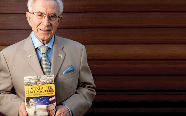 "Ben Lesser with his book, ""Living A Life That Matters."""