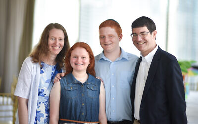 Alan Minsk, right, with his wife Julie, left, and their children Kayla and Matthew.