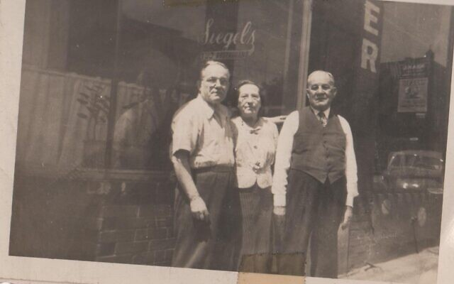 Raizel and Jacob Siegel with son Yoshi, left, in front of their original location before moving next door to a larger wooden building.