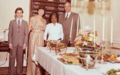 Ivan and Shirley Millender stand with their son Michael and top-tier Atlanta caterer Nellie Peterson, who meticulously prepared and presented the food for Michael's bar mitzvah.
