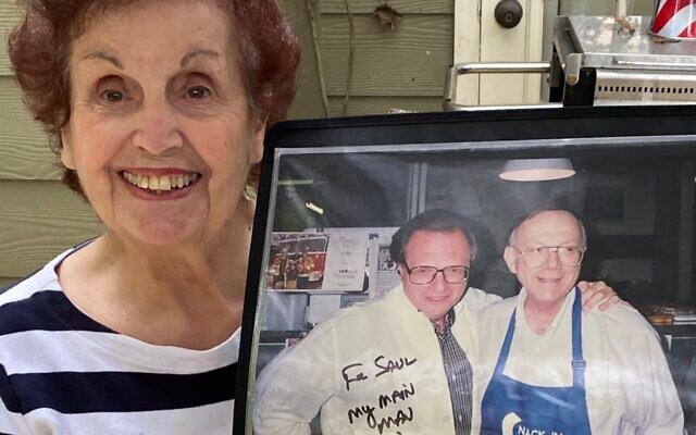 Renee Feldman shares a signed photo of Larry King and her husband Saul at the deli counter.