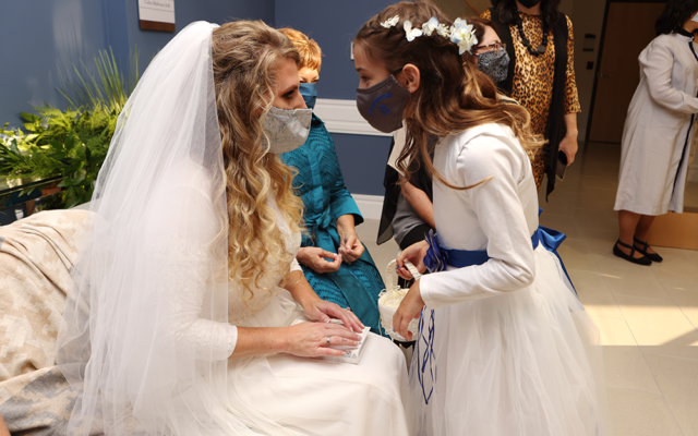 Jennifer and step-daughter Chana don masks.