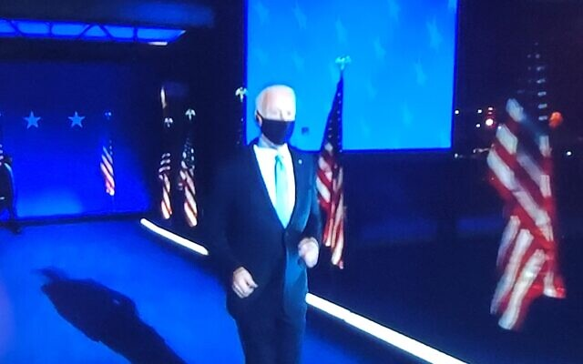 Biden jogs onto the stage to give his victory speech his home town of Wilmington, Delaware,