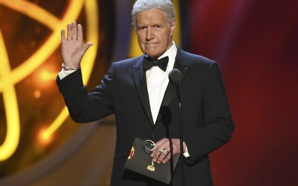 "This May 5, 2019, file photo shows Alex Trebek gestures while presenting an award at the 46th annual Daytime Emmy Awards in Pasadena, Calif. Jeopardy!"" host Alex Trebek died Sunday, Nov. 8, 2020, after battling pancreatic cancer for nearly two years. Trebek died at home with family and friends surrounding him, ""Jeopardy!"" studio Sony said in a statement. Trebek presided over the beloved quiz show for more than 30 years. (Photo by Chris Pizzello/Invision/AP, File)"