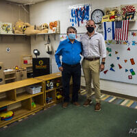 Itamar Kleinberger, left, co-founder of Aguair, tours the MJCCA with CEO Jared Powers.