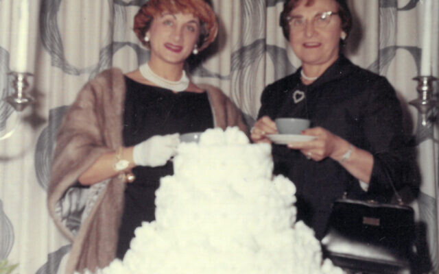 Estelle Karp, standing at left, attends a Silver Tea program with a Sisterhood friend in the early '60s.