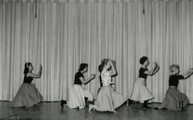Members dance in a Sisterhood program on the AA stage.