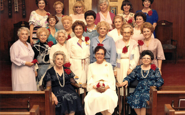 Reva Epstein, front row center, and former president Franceen Tillem, top row, third from left, are joined by past Sisterhood presidents celebrating Sisterhood's 60th anniversary in 1980.