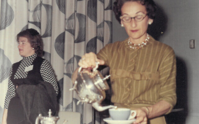 A member pours into her cup during a Sisterhood Silver Tea program.