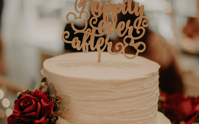 "Nathalia Frykman Photography // The wedding cake had a Disney-themed ""Happily Ever After"" cake topper."