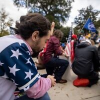 """Supporters of President Donald Trump pray about the results of the election at a """"Stop The Steal"""" rally Saturday. // Nathan Posner for the AJT."""