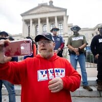 """Chris Hill and his Georgia Security Force militia members are seen at a """"Stop The Steal"""" rally at the state capitol. // Nathan Posner for the AJT."""
